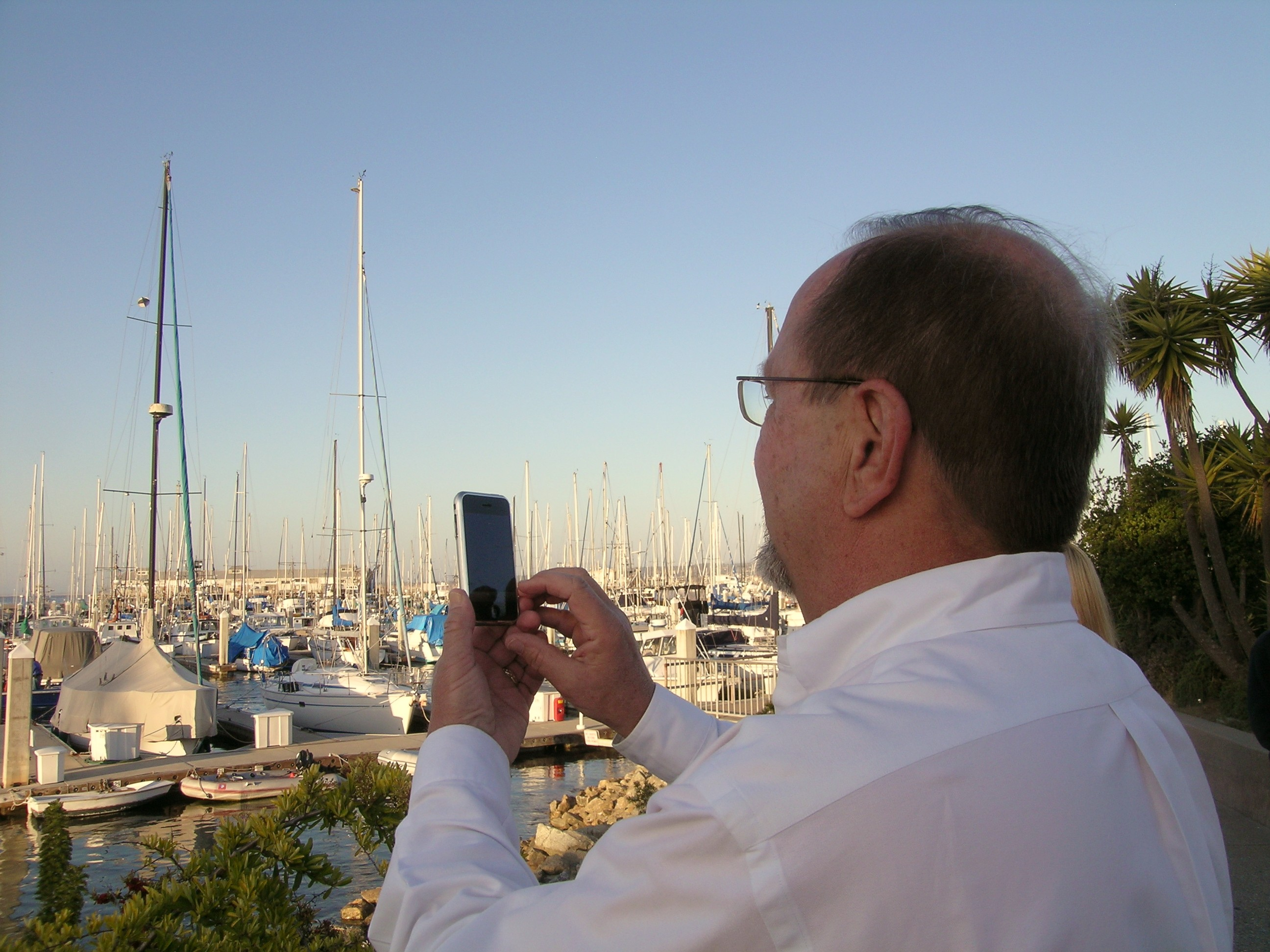 Michael Stumpf taking a photo of the boats at Fisherman\'s Wharf